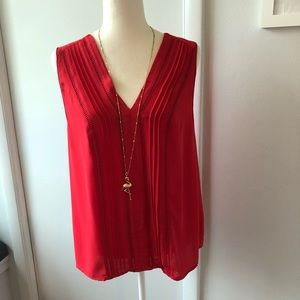 Q&A Red sleeves top. Size large.